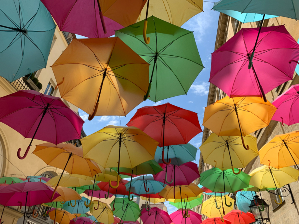 colored umbrellas street color sky colorful floating bright pattern outside multicolored art creative