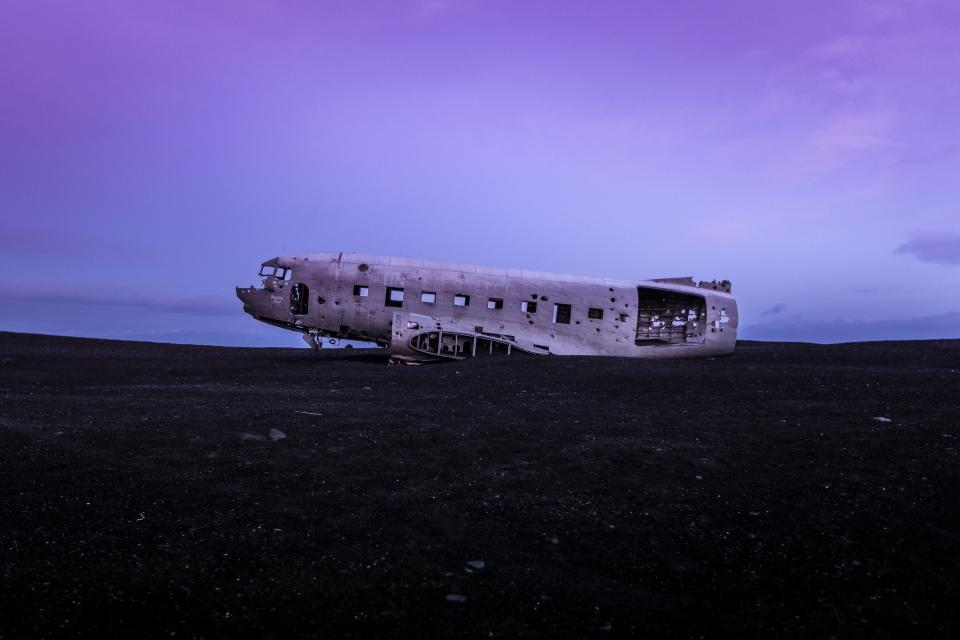 airplane crash damage wreck purple sky clouds dusk evening night