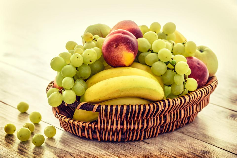 fruit basket table food banana green grapes red apple dessert