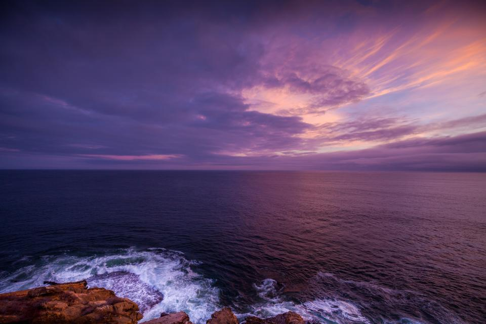 ocean sea water horizon landscape shore coast sunset dusk sky clouts purple