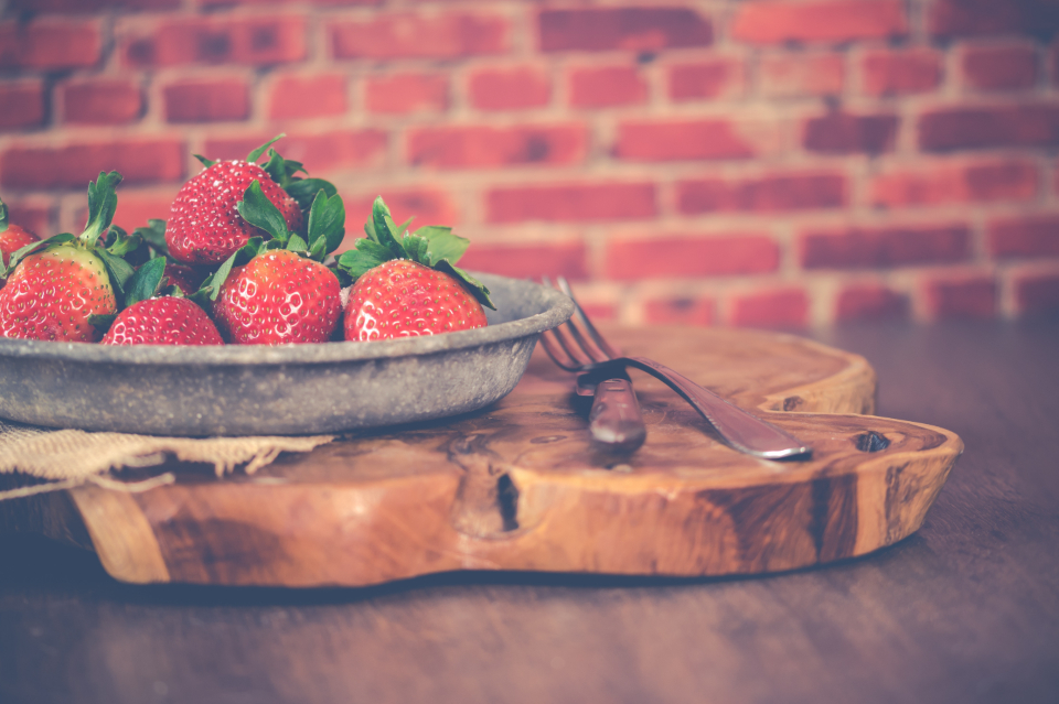 strawberries fresh plate wood table brick wall brick wall fruit food healthy fork