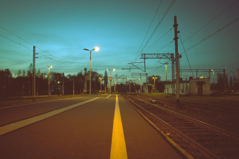 road street railway track travel transportation dark night lights outdoor
