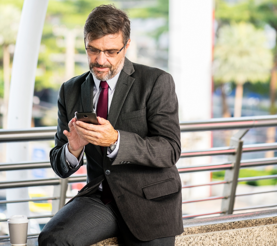 bearded businessman busy cbd chatting checking chongnonsi city city center connected corporate device digital device downtown grey hair looking man mature messaging mobile phone network notes on soc