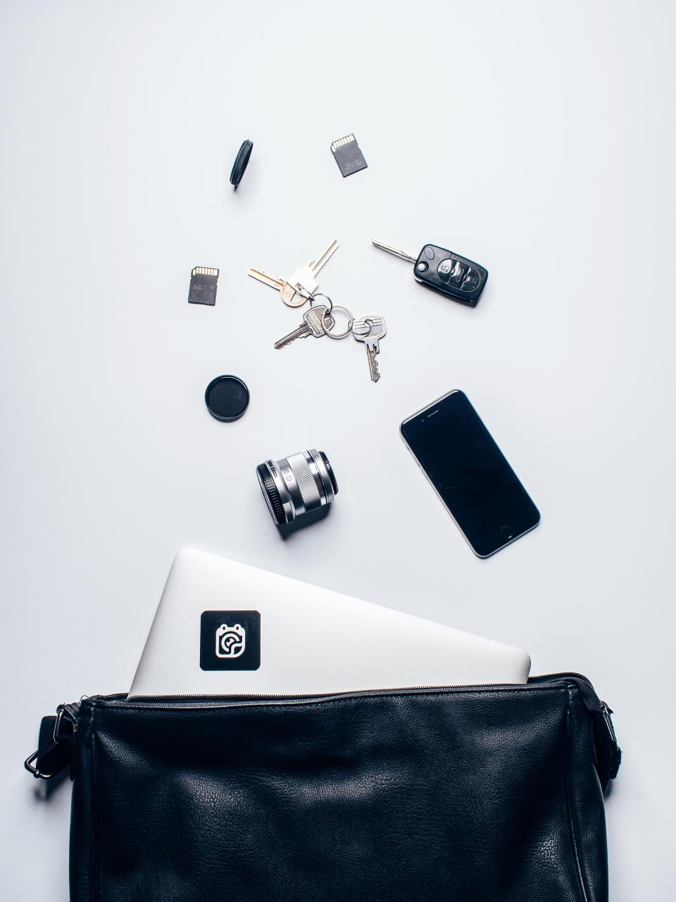 leather bag laptop computer technology iphone mobile lens keys sd card objects white