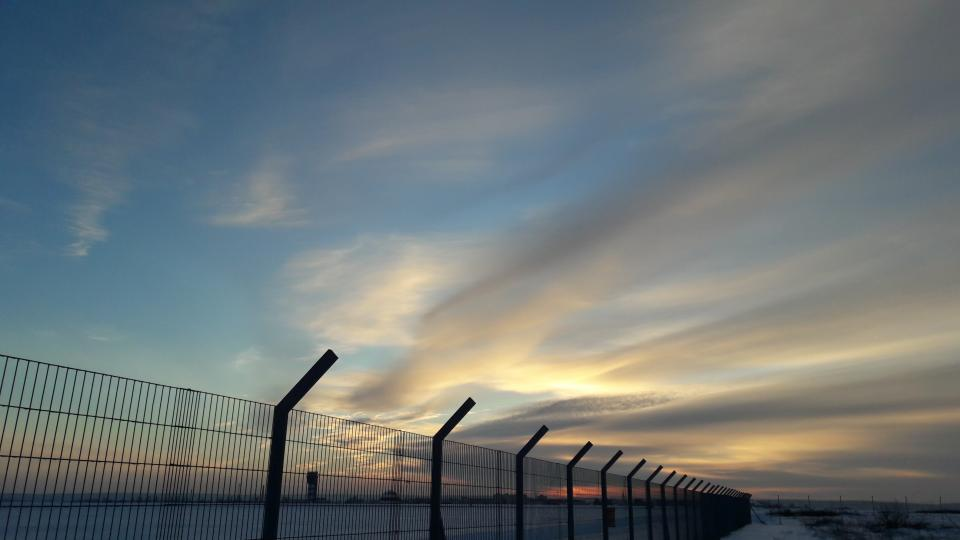 sea ocean blue water nature clouds sky fence