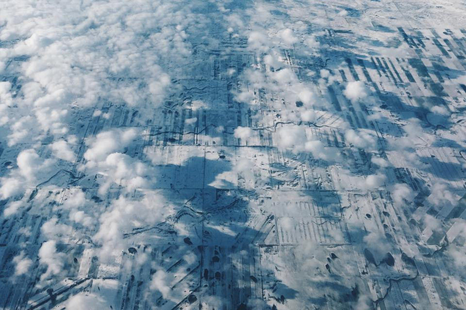 above the clouds aerial view fields