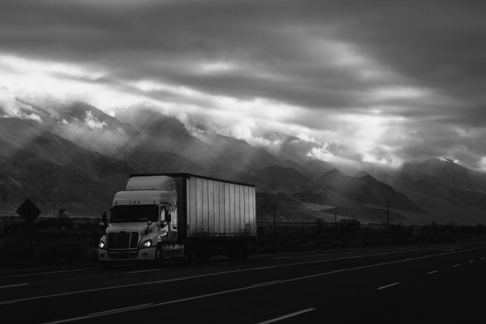 road truck van vehicle travel trip mountain highland landscape sky clouds transmission line