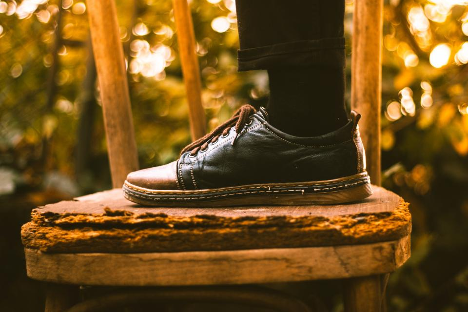 footwear shoe black sock chair bokeh blur