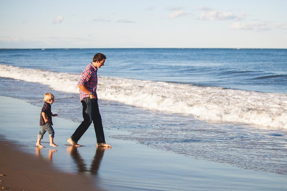sea ocean water waves nature sand beach coast shore horizon blue sky people man father kid child boy travel