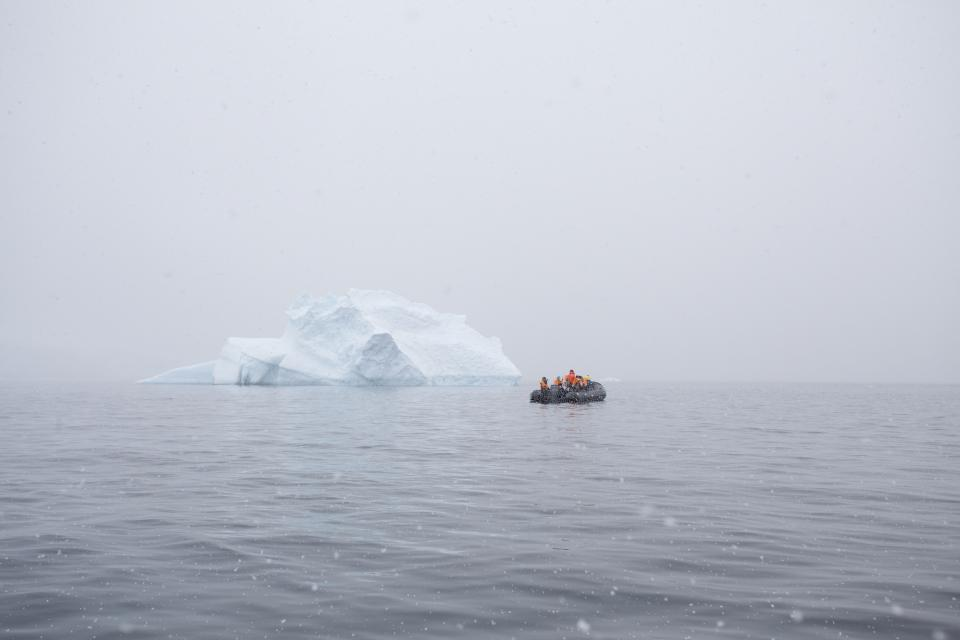 nature water ice berg people boat