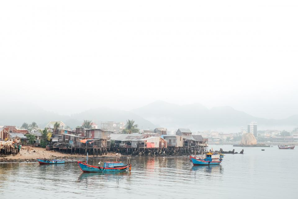 nature landscape water ocean sea boat household slum fog mountain