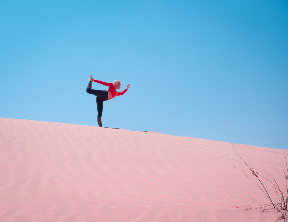 woman fitness stretch yoga run jog fit sand dune beach blue sky blonde pose portrait