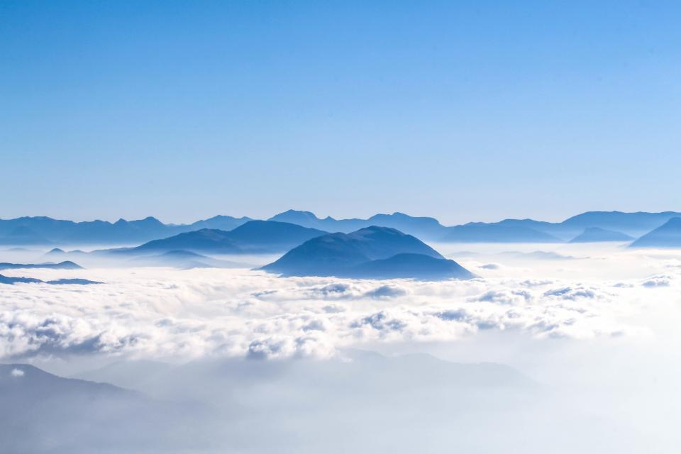 aerial mountain clouds sky blue white nature