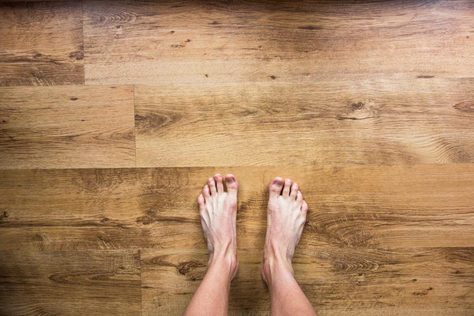 barefoot bare feet floor hardwood