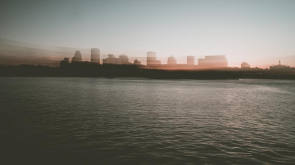 architecture building infrastructure skyline city urban dark sea water horizon blur