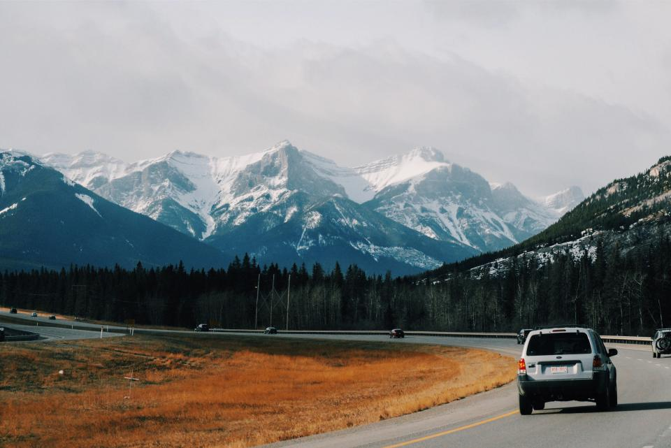 car vehicle travel road trip street grass trees mountain valley hill landscape nature snow winter cold fogs