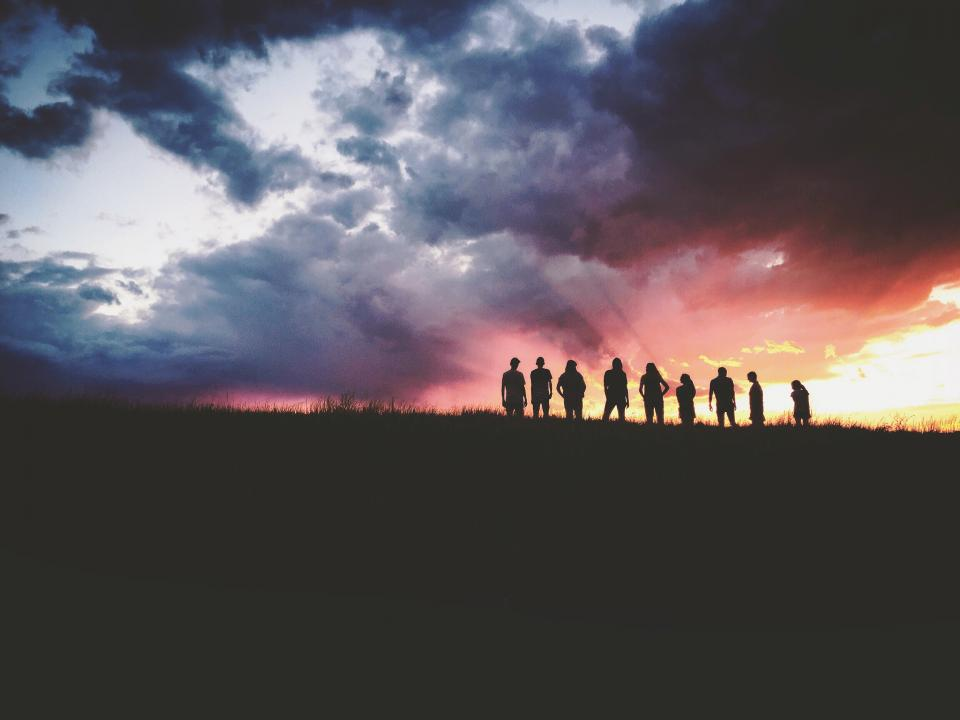 mountain highland dark cloud sky sunset peak landscape nature valley people travel friends bond family silhouette