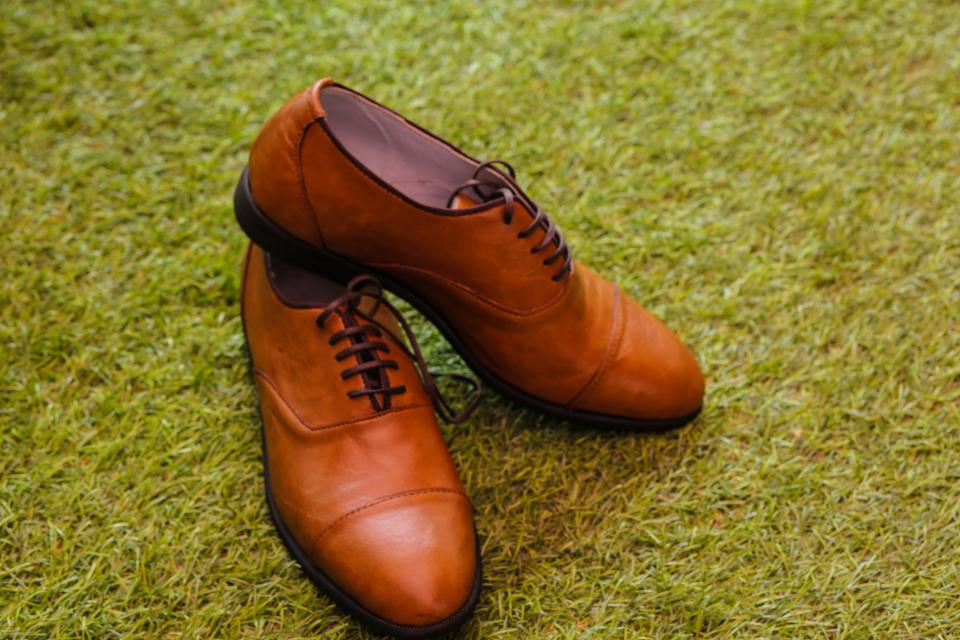 brown shoe footwear leather green grass