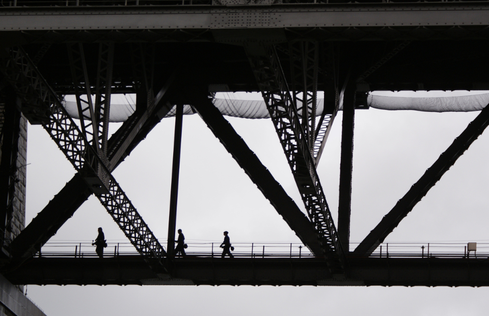 people crossing bridge monochromatic silhouette city modern skyline pedestrians citizens cityscape figures engineering architecture walking urban