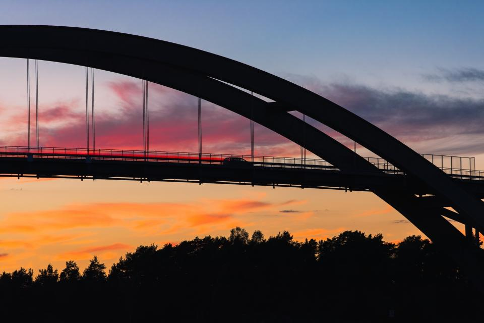 architecture bridge infrastructure sky clouds sunset trees plant view