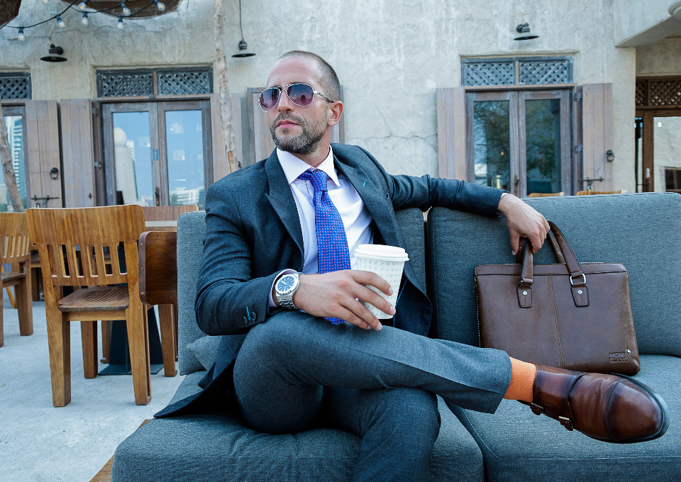 man sunglasses waiting fashion model suitcase business shoes socks orange watch style bar restaurant drink coffee