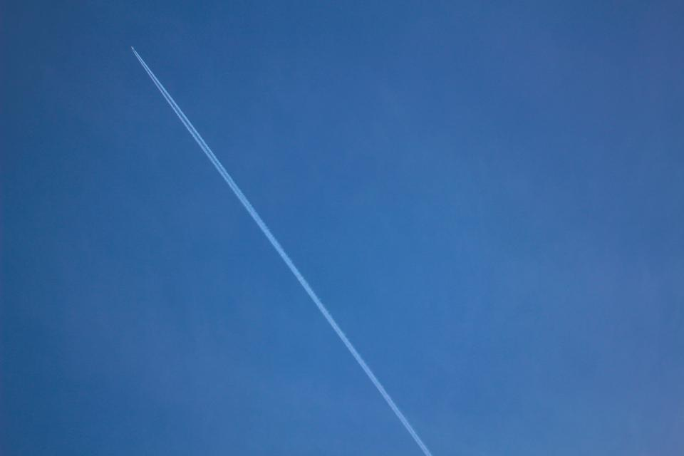 airplane contrails blue sky