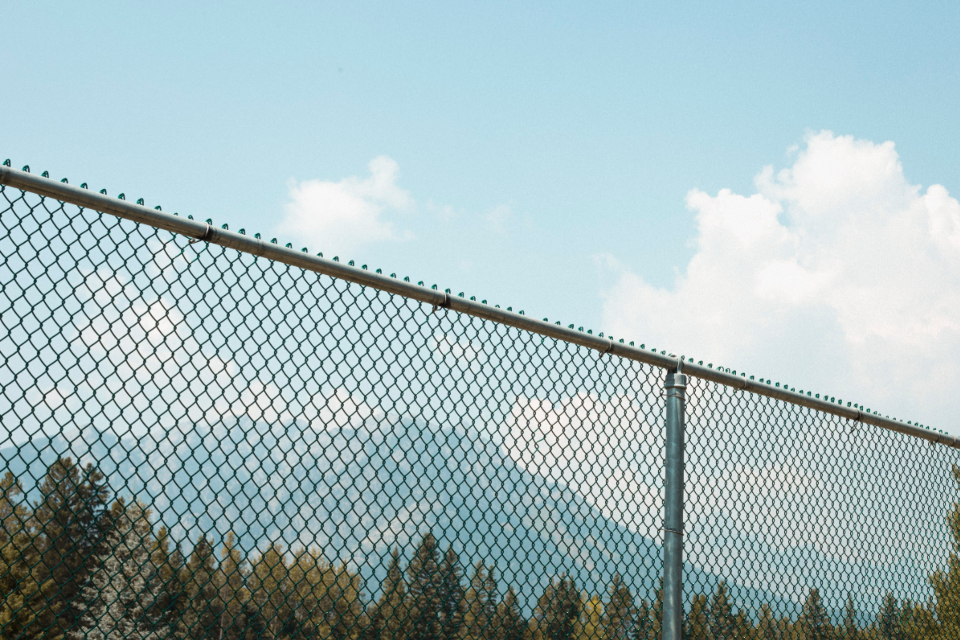 tennis fence sports mountains hip indie photo sporty rocky mountains sky clouds summer sunshine trees