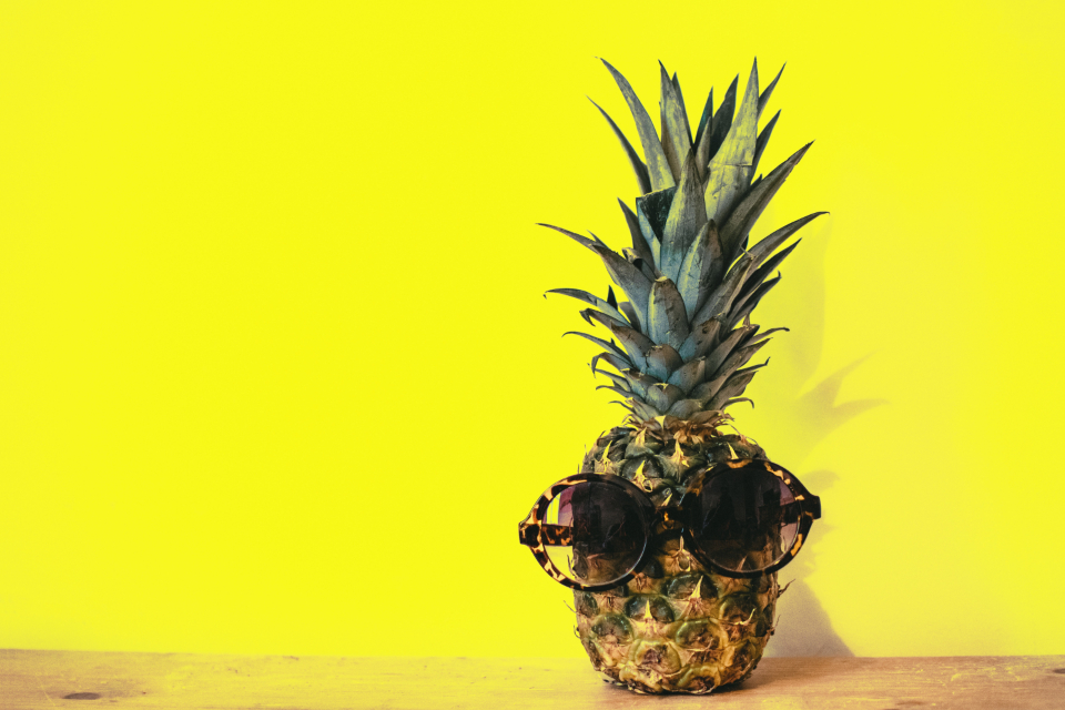 pineapple sunglasses yellow background minimal table wood food fruit fun quirky