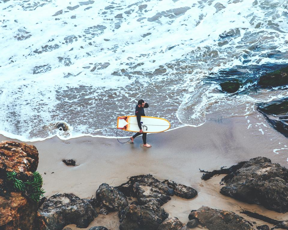 people man surf waves ocean sea beach vacation adventure aerial rocks sand