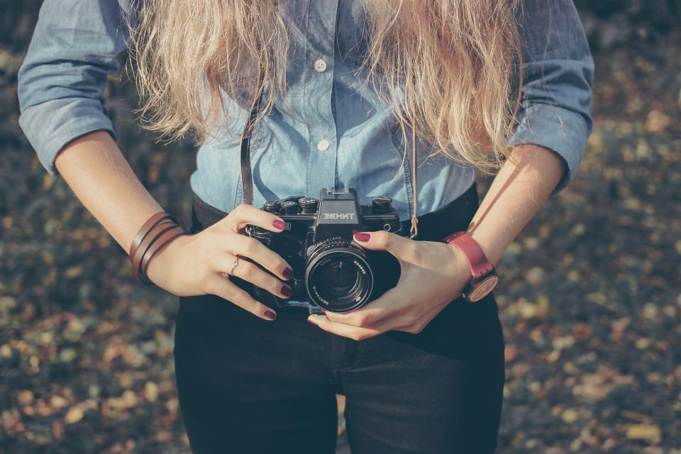 people woman camera photographer accessories leather fashion photography vintage lens manicure blonde hands