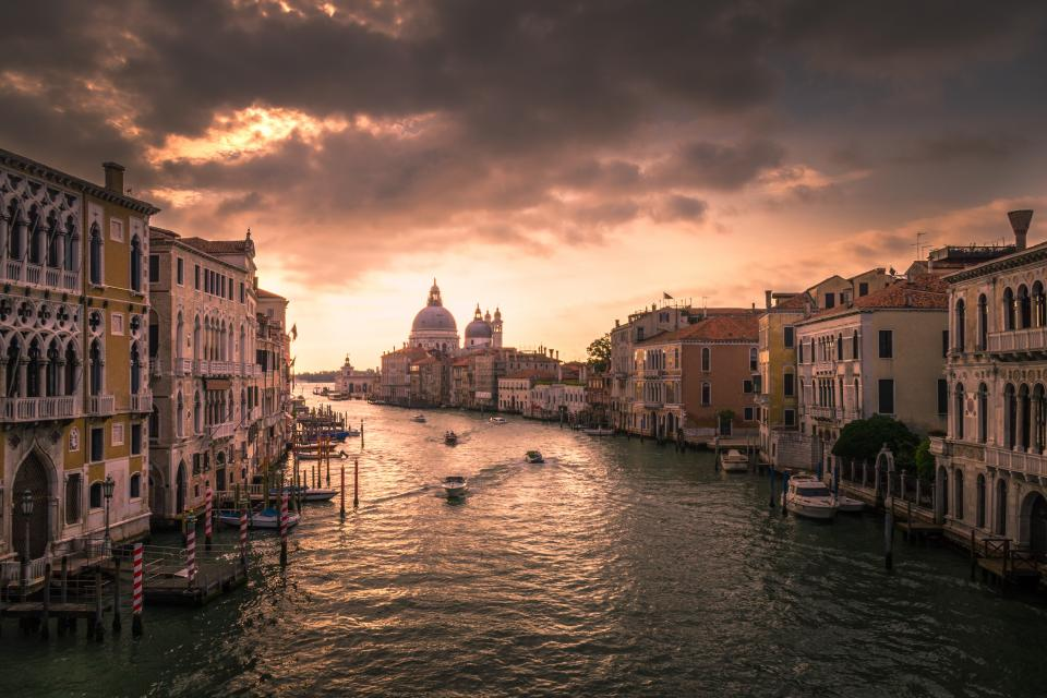 architecture building infrastructure sky cloud sunset canal water italy boat