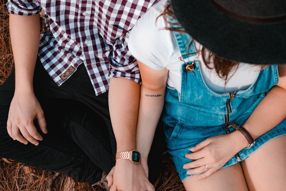 people woman man guy lady watch holding hands couple married lovers jumper tattoo jeans grass wood
