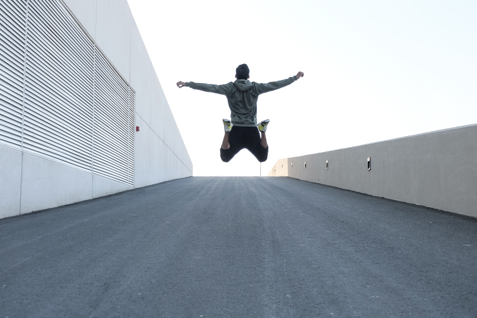 man jumping road healthy fit leap sport city concrete fitness