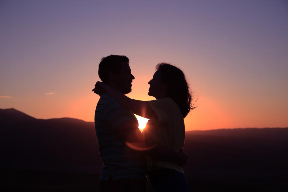 people woman man hug love couple sunset silhouette