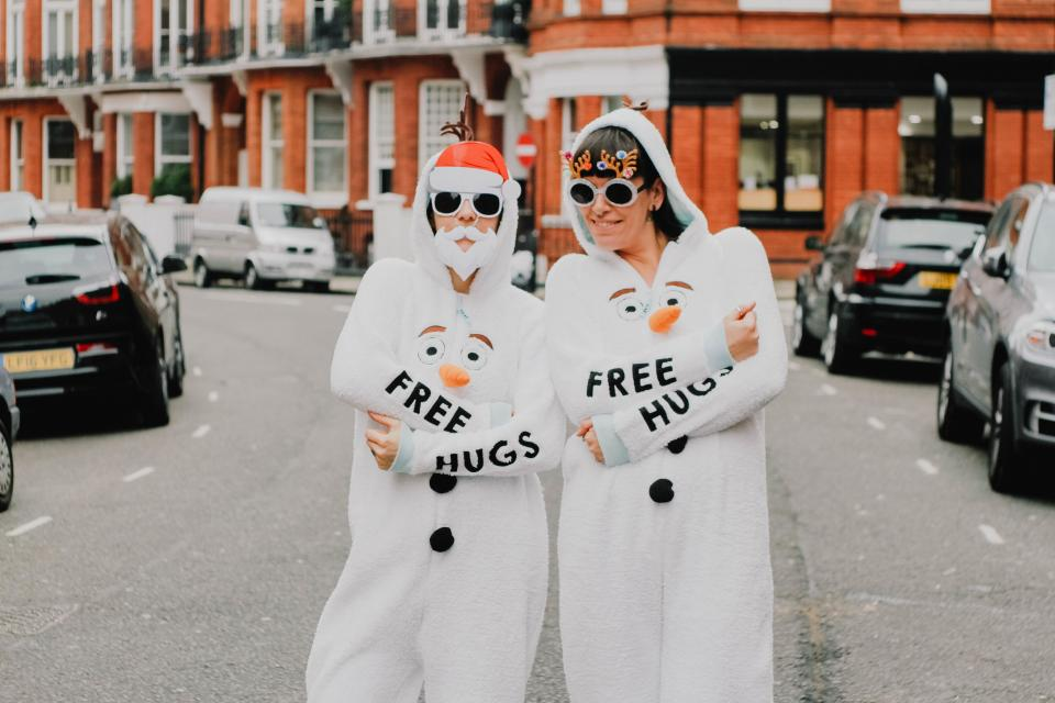 free hug people woman shades onesie costume cause olaf frozen animation disney urban city car happy vehicle building