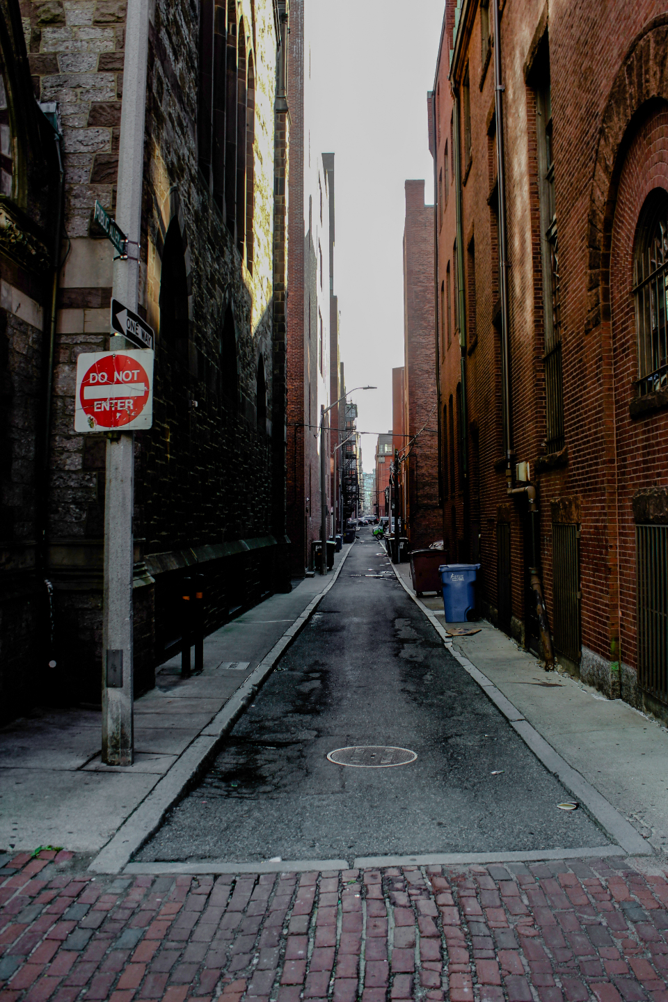 alley city street downtown brick cobblestone buildings deserted exterior urban sign narrow architecture