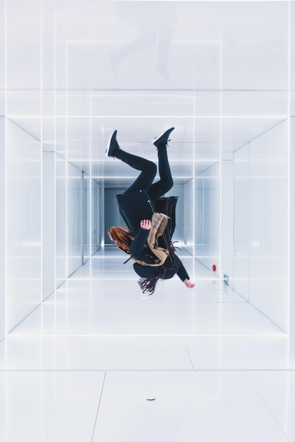 building white indoor wall floor people woman jump reflection