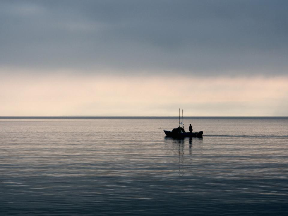 fishing fisherman boat morning lake water sky dawn