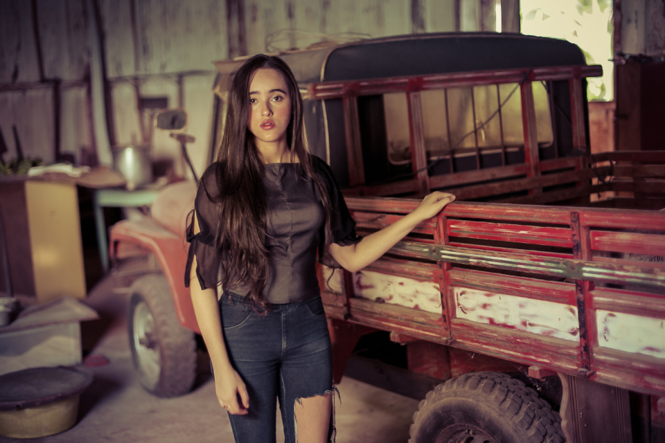 young woman vintage truck transport people person brunette lorry rustic old girl female