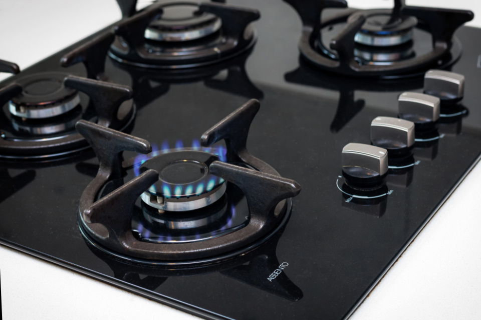 gas stove flames fire cooking kitchen appliance