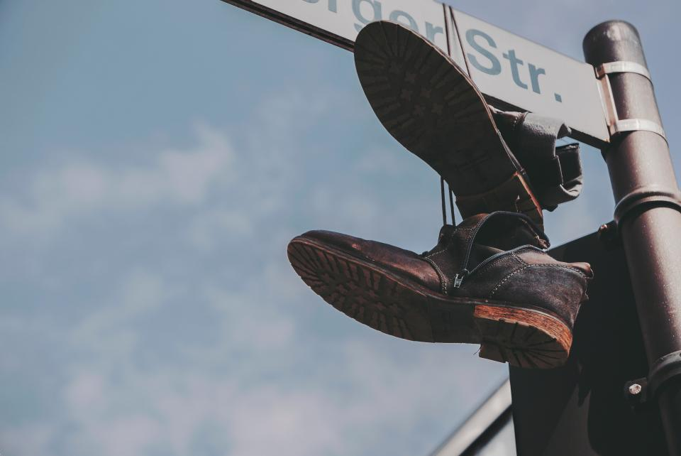 clouds sky street sign shoe footwear hang