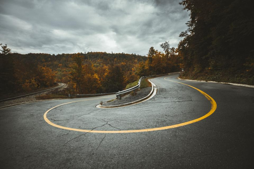 road curve travel trees plant nature highland autumn fall blue sky clouds