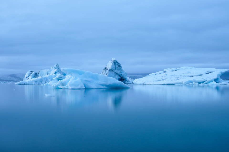 iceland iceberg water ice cold winter snow freezing sky clouds nature outdoors environment climate arctic blue cool glacier floating majestic sea tourism travel