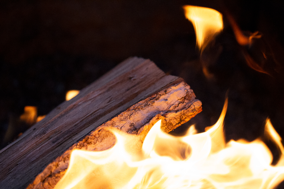 campfire wood closeup flame fire camp heat burn fireplace char charcoal energy blaze fuel split detail glow