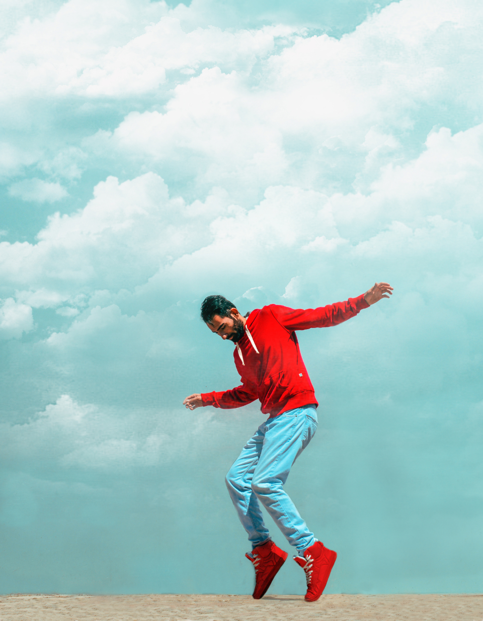 man casual dance red hoodie sweatshirt balance fun clouds pose portrait style