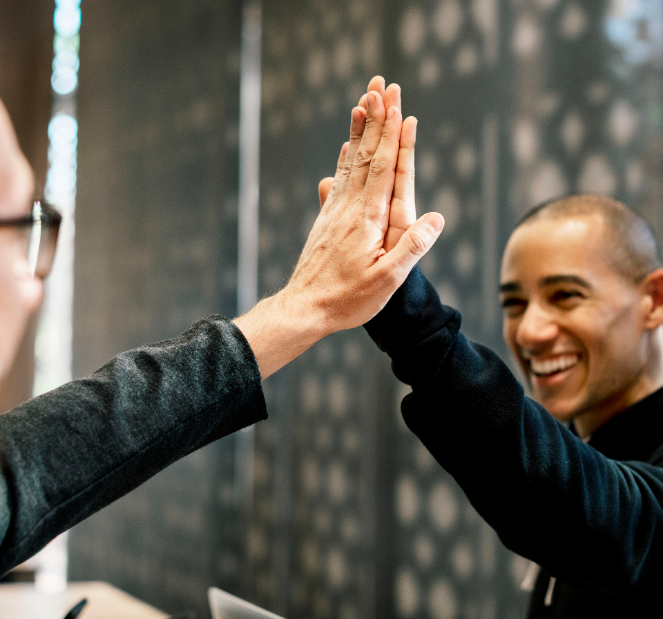 achievement agreement cheerful colleague communication cooperation deal diverse expression friends greeting group hands happiness high five man meeting partners partnership people power smiling success support team team building teamwork arms