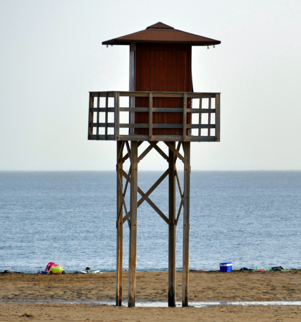beach lifeguard tower ocean water sea shore sky outdoors vacation travel relax horizon coastline sand