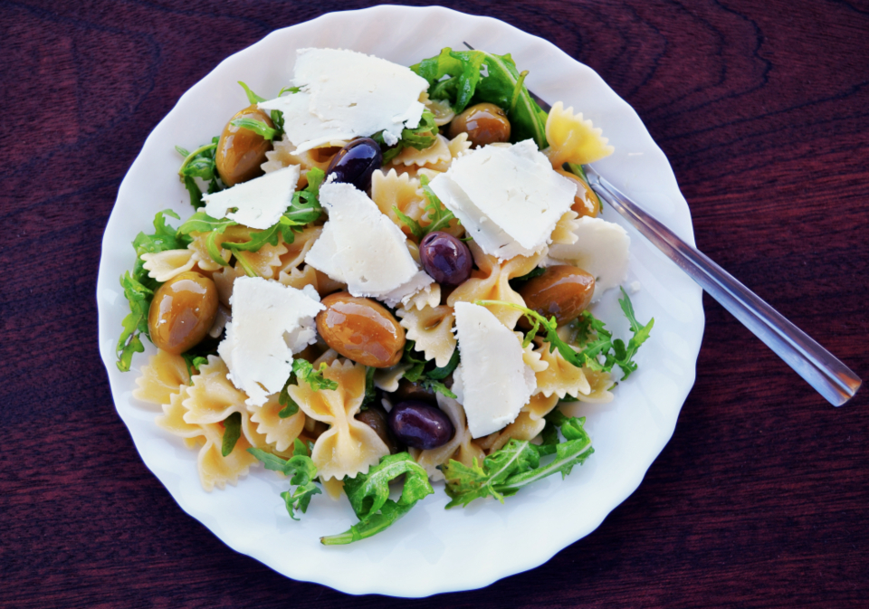 pasta salad olives feta cheese arugula mediterranean vegetarian fusilli pasta healthy cheese appetizer dinner cuisine food plate fresh greek diet delicious italian vegetable