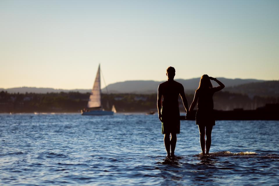 ocean sea lake water sailboat guy man girl woman couple love romance people silhouette shadow summer landscape