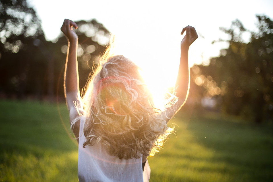 woman sunshine happy field park trees nature people blonde hair hair blonde female arms free